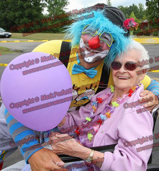 Willie the clown poses with Catherine Acela
