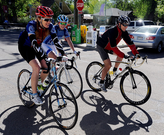 """Connie Carpenter-Phinney, left, daughter Kelsey, and Davis Phinney, leave Niwot to continue the charity ride to battle Parkinson's disease.<br /> The fourth annual Road to Victory Bicycle Classic, benefiting the Davis Phinney Foundation, took place Sunday around Boulder County.<br /> For more photos, go to  <a href=""""http://www.dailycamera.com"""">http://www.dailycamera.com</a>.<br /> Cliff Grassmick / May 23, 2010"""