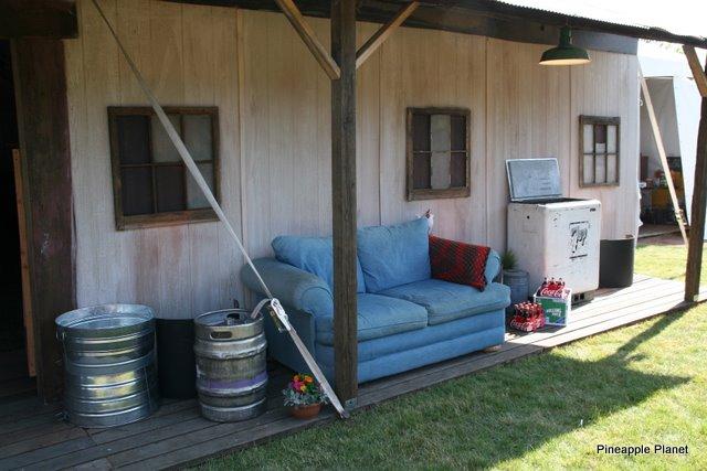 Custom Built front porch on 60 x 80 tent ~ Wood walls, custom overhang, porch, windows, wood trim, props & decor