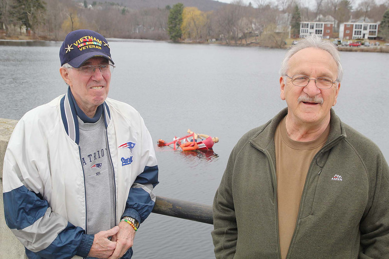 Private Rocky hit the water last Friday in the Leominster Veteran Memorial Center's Ice Out fundraiser. Veteran's Capt. Bob Bray and 2nd Class Petty Officer Ralph Sacramone talk about the fundraiser as the stand on the bridge over Rockwell Pond behind the center where Rocky is waiting to be rescued. SENTINEL & ENTERPRISE/JOHN LOVE