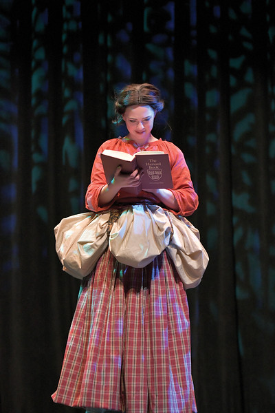 "Matthew Gaston | The Sheridan press<br>Mallory Arneson as Cinderella enjoys a book gifted to her by Jean-Michel before Madame and her terrible step-sisters return to shatter her solice during the dress rehearsal for ""Cinderella"" Tuesday, Feb. 25, 2020."