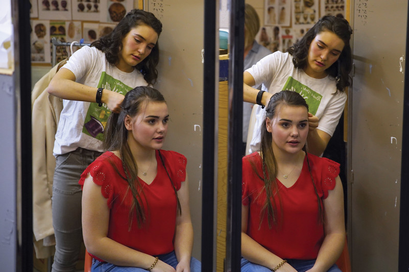 Matthew Gaston | The Sheridan press<br>Alice Anderson works on braiding Micall Hoopes' hair in preperation for the dress rehearsal of Sheridan High School's production of Rodgers and Hammerstein's Cinderella Tuesday, Feb. 25, 2020.
