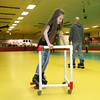 Roll On America in Lancaster hosted a sensory-friendly skating event on Tuesday morning. Getting a little help as she skates around during the event is Leila Hammad, 8, of Fitchburg. SENTINEL & ENTERPRISE/JOHN LOVE