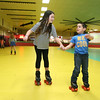 Roll On America in Lancaster hosted a sensory-friendly skating event on Tuesday morning. Helping each other out as they skate during the event is Alexis Gamache, 9, of Holden and Mason Ramos, 5, of Spencer. SENTINEL & ENTERPRISE/JOHN LOVE