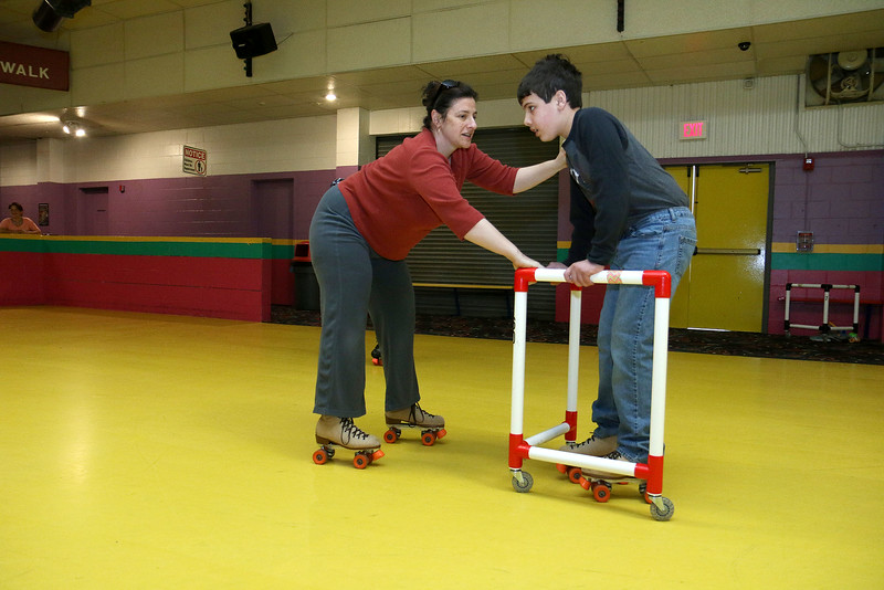 Roll On America in Lancaster hosted a sensory-friendly skating event on Tuesday morning. Marla Haddad helps out her son Sam Champey, 12, as he learns to skate during the event. SENTINEL & ENTERPRISE/JOHN LOVE