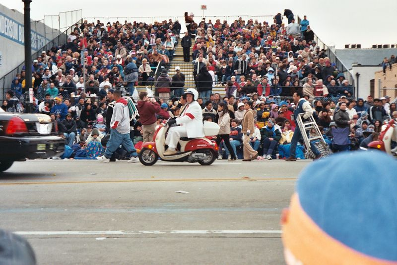 A parade official on their scooter in front of one of the smaller grandstands.  We ended up at least 6-7 people deep on our side, and didn't have bleachers at all.