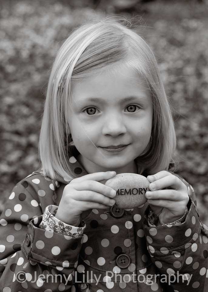 pretty blonde girl with engraved message stone in black and white