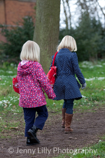 pretty children in woods of snowdrops