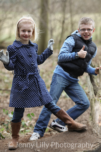 bother and sister playing  in woods