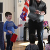 Celebration of Roudenbush Community Center reopening after renovations. Trevor Welt, 4, of Acton, helps magician Dave Anderson of Newton, N.H., who turned red, white and blue handkerchiefs into a flag. (SUN Julia Malakie)