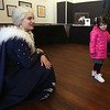 Celebration of Roudenbush Community Center reopening after renovations. Alanna Keaveny, 3, of Westford, looks shyly at Elsa from Dream Princess. (SUN Julia Malakie)