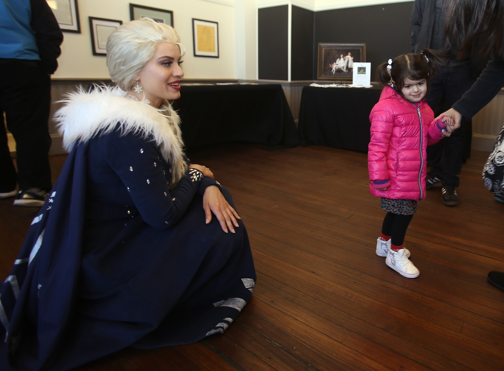 . Celebration of Roudenbush Community Center reopening after renovations. Alanna Keaveny, 3, of Westford, looks shyly at Elsa from Dream Princess. (SUN Julia Malakie)