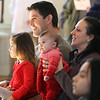 Celebration of Roudenbush Community Center reopening after renovations. William and Elizabeth Cielakie of Westford, with daughters Liliana, 3, and Juliette, 3 months, watch the magic show. (SUN Julia Malakie)