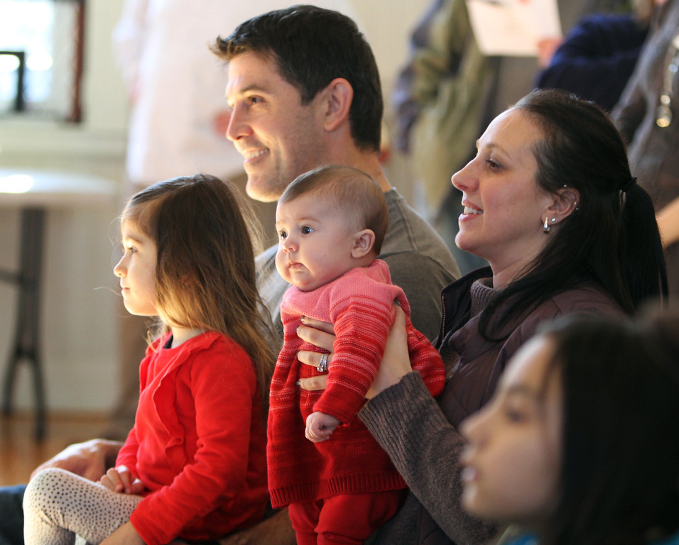 . Celebration of Roudenbush Community Center reopening after renovations. William and Elizabeth Cielakie of Westford, with daughters Liliana, 3, and Juliette, 3 months, watch the magic show. (SUN Julia Malakie)