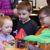 Celebration of Roudenbush Community Center reopening after renovations. From left, Addison Casserly, 4, Henry Esposito, 6, and Daniel Costa, 6, all of Westford, who did not know each other, play.  (SUN Julia Malakie)