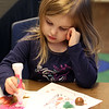 Celebration of Roudenbush Community Center reopening after renovations. Chloe Webb-Nash, 4, of Chelmsford, colors with markers. (SUN Julia Malakie)