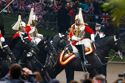 Horseguards. The guy at the front looks like he's surprised to discover a black man in the regiment.