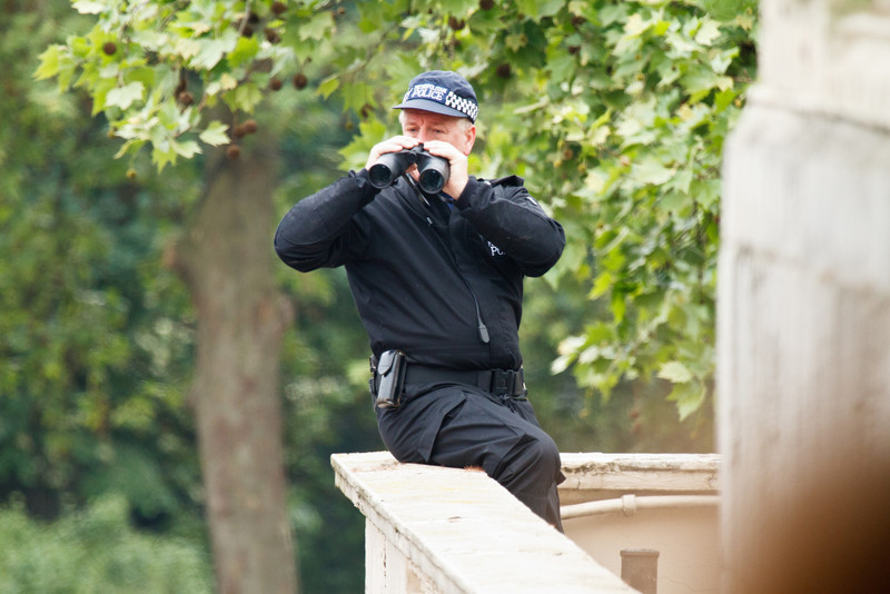 Police officer on the lookout for trouble or portable guillotines.