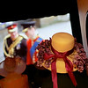 """Record-Eagle/Jan-Michael Stump<br /> Pat Light (cq), dressed as """"Lady Luella Hoppe Meadowbrook,"""" watches Princes Harry and William arrive at Westminster Abbey for William's wedding on the screen at the State Theatre early Friday morning."""