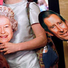 Record-Eagle/Jan-Michael Stump<br /> Amy Daniels Moehle (cq), left, and Chris Daniels (cq), right, hold their Queen Elizabeth and Prince Charles masks as they arrive at the State Theatre early Friday morning to watch the British royal wedding.