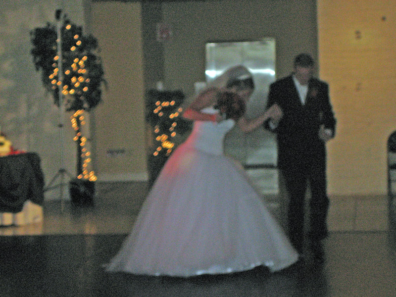 Meg and Phil make grand entrance at reception