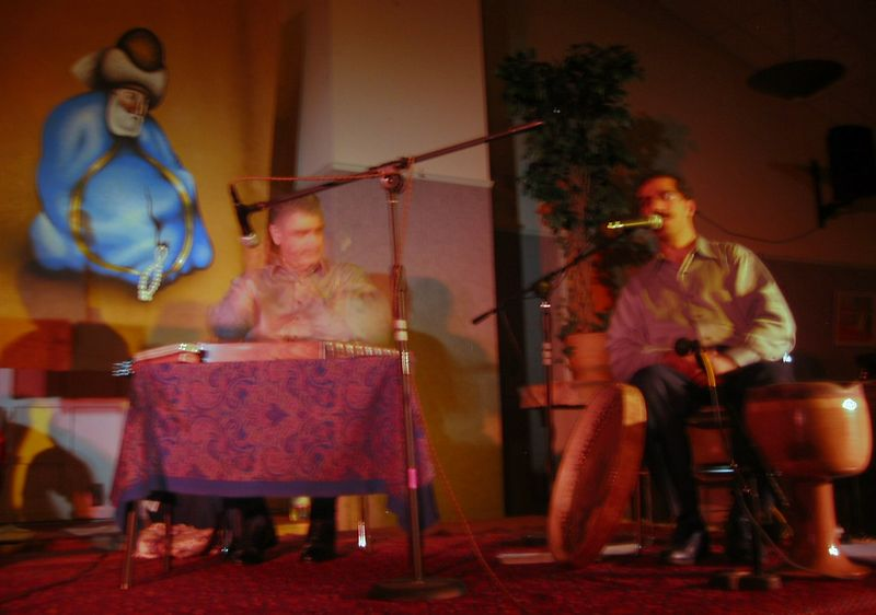 Mohammad Nahavandi from Iran on santour and Shahram Mazhari, college professor from Charlotte, on daf frame drum (blurry)