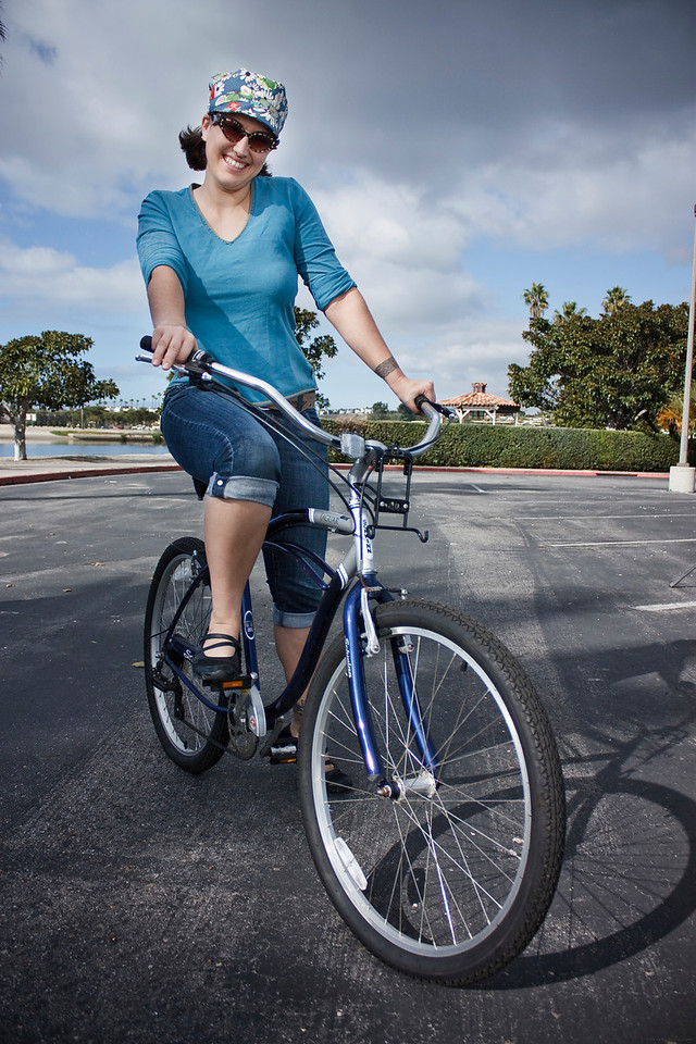 """Linda posing for a quick shot while on her beach cruiser. She rode it in the background of the scene to provide that """"Beach"""" atmosphere."""