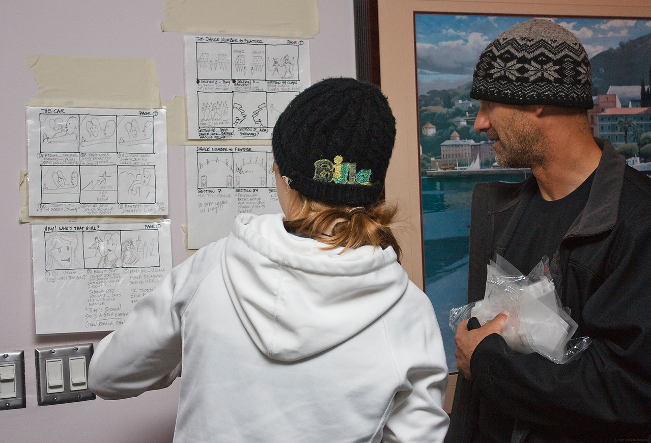 Richard (Director) goes over the storyboard with Courtney (Production Assistant). They are trying to figure out which scenes can be shot even though it is raining.