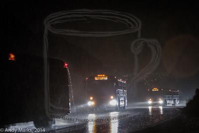 Runners shuttle to Alta,UT in a dark downpour.