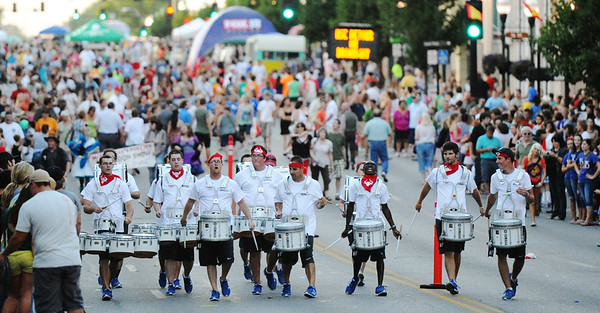 Globe/T. Rob Brown<br /> A large crowd lines either side of Main Street as the Royal Thunder drumline performs at the Running of the Bulls Thursday evening, July 19, 2012, during the downtown Joplin event.