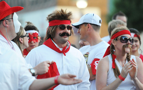 Globe/T. Rob Brown<br /> Costumes R Us: Running of the Bulls participants wear fake mustaches Thursday evening, July 19, 2012, during the downtown Joplin event on Main Street.