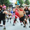 Globe/T. Rob Brown<br /> Members of the MO-KAN Roller Girlz surround a Running of the Bulls participant Thursday evening, July 19, 2012, during the downtown Joplin event on Main Street.