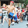 Globe/T. Rob Brown<br /> A Running of the Bulls participant reacts to being hit by a member of the MO-KAN Roller Girlz Thursday evening, July 19, 2012, during the downtown Joplin event on Main Street.
