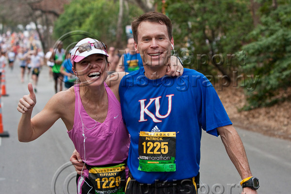 One of the many happy couples running the marathon at the 11 mile split.
