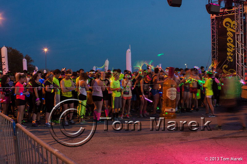 Over 10,000 runners wait for the sun to set to start the Electric Run