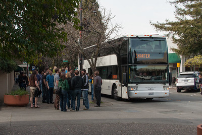Folks gather in front of the bus after unloading in Santa Rosa, Calif.