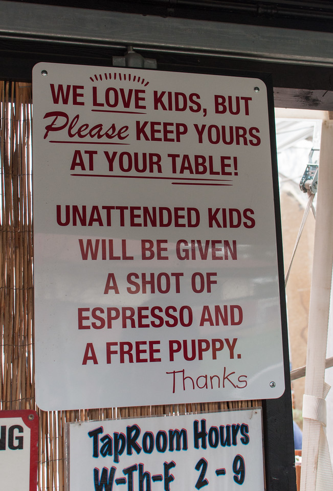 A sign adorns the entrance of the Lagunitas tap room and beer garden.