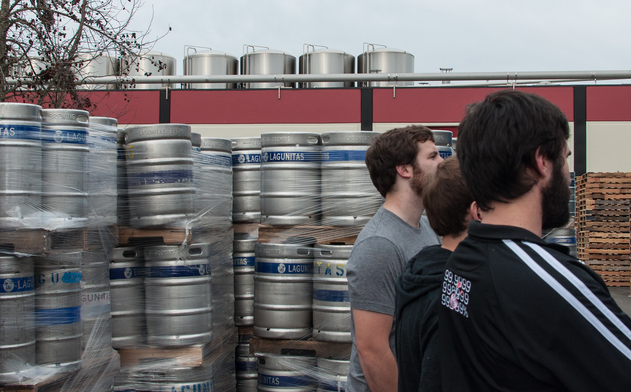 Kegs and fermenters visible from the parking lot outside the Lagunitas brewery.