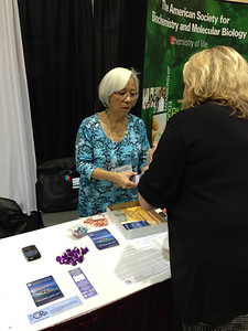 Dr. Ida Chow (Executive Director) at the Society for Developmental Biology exhibit booth at the SACNAS 2012 Conference.