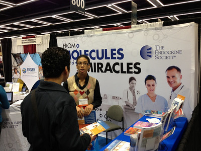 Ms. Danielle Raiford (Trainee & Awards Program Coordinator) at The Endocrine Society exhibit booth at SACNAS