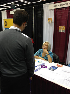 Dr. Ida Chow at the Society for Developmental Biology exhibit booth at SACNAS 2012