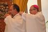 Bishop Bressanelli (right) checks Bishop Musialek's collar