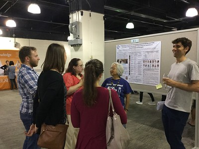 Dr. Ida Chow (SDB) with meeting attendees during poster session