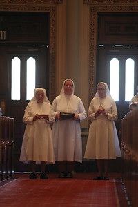 Our Sisters, the Daughters of Mary Help of Christians, present the gifts at mass.