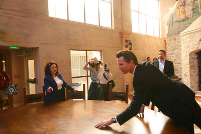 Mayor Gavin Newsom gets a first look at the National Shrine Of Saint Francis of Assis.  Inside Angela Alioto tells the mayor about the siteÕs history as he touches the round table of the Knights of St. Francis.  The event was to announce, ÒThe Renaissance ProjectÓ, a plan to transform the location into an international Spiritual Center to serve as a place for peace and inspiration. The project spearheaded by Angela Alioto, began with the construction of the only replica of St. FrancisÕ famed, ÒPorziucolaÓ, or ÒLittle corner of the worldÓ. St. Francis himself originally restored the original location in his home city of Assisi, Italy.