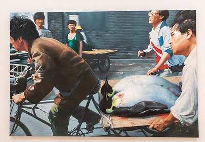This painting is a copy of a photograph which was taken when the wounded students were being transported to hospitals after being shot at Tienanmen.  The students were replaced by penguins.