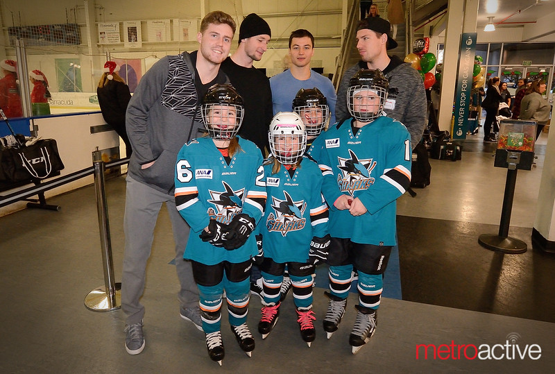 A Young Girls Hockey Team (not associated with the event) Spotted Their Heroes At The Practice Rink Who Posed For A Quick Picture