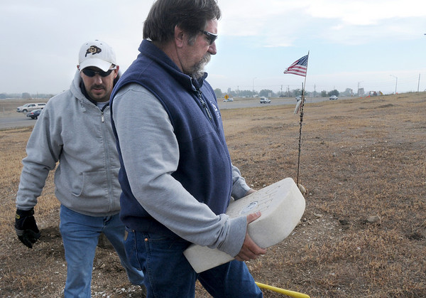 BE1018SHEP12.jpg BE1018SHEP12<br /> Rick Sedbrook, right and Jeff Kissinger, Broomfield Parks, carry the marble grave marker for Shep the Turnpike Dog during the move of Shep's grave from the intersection of Hwy. US 36 and Hwy. 121 to the Depot Hill Museum on Wednesday.<br /> October 14, 2009<br /> Staff photo/David R. Jennings