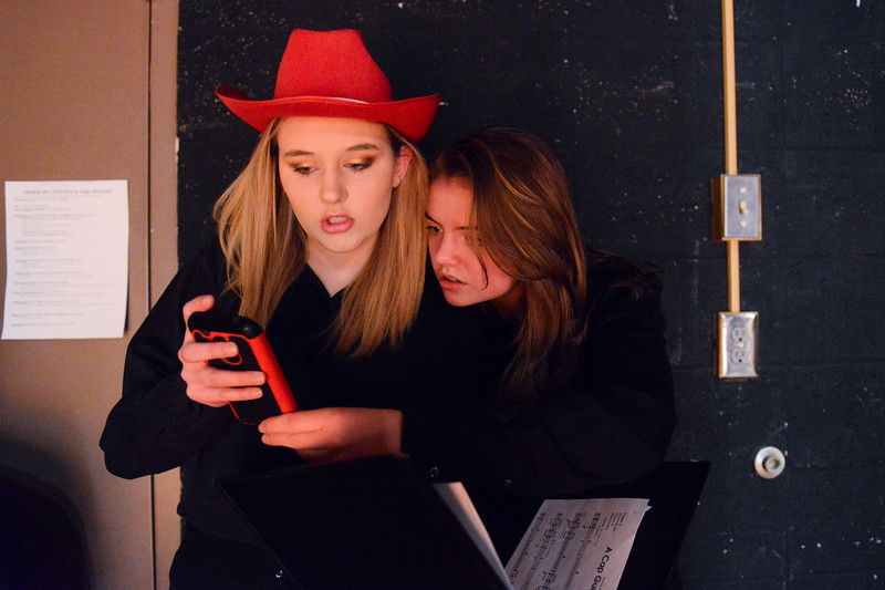 Justin Sheely | The Sheridan Press<br /> Musicians Logen Livingston, left, and Kinsey Hegy wait backstage during the Sheridan High School band department's winter concert at the Sue Henry auditorium at Sheridan High School Tuesday, Dec. 19, 2017.