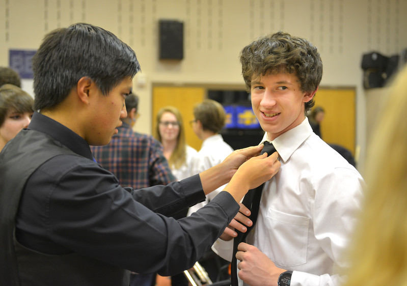 Justin Sheely | The Sheridan Press<br /> Band members Tristan Choong, left, straightens Alex Garber's tie before the Sheridan High School band department's winter concert at the Sue Henry auditorium at Sheridan High School Tuesday, Dec. 19, 2017.